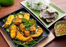 Bloomberg touts Cha Ca La Vong as a must-try dish for gourmets